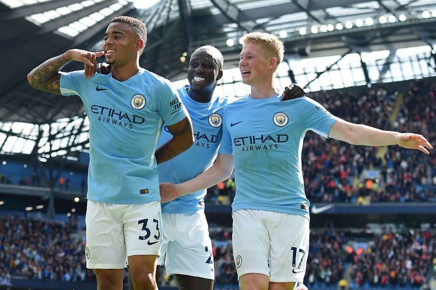 Manchester City's Gabriel Jesus (left) celebrates with Benjamin Mendy and Kevin De Bruyne (right) after scoring their second goal.