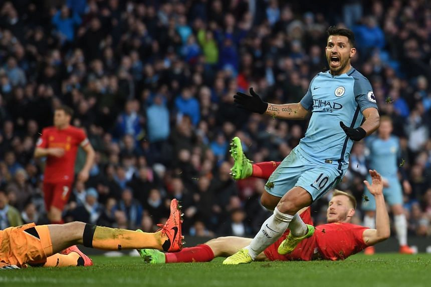 Manchester City's Argentinian striker Sergio Aguero celebrates after scoring during the English Premier League football match between Manchester City and Liverpool at the Etihad Stadium in Manchester, north west England, on Mar 19, 2017.