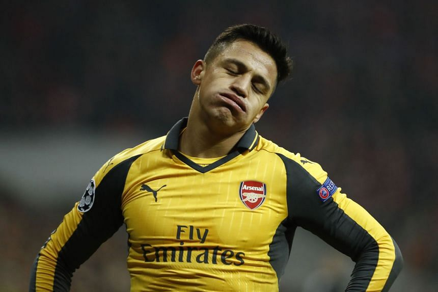 Arsenal's Chilean striker Alexis Sanchez reacts during a match.
