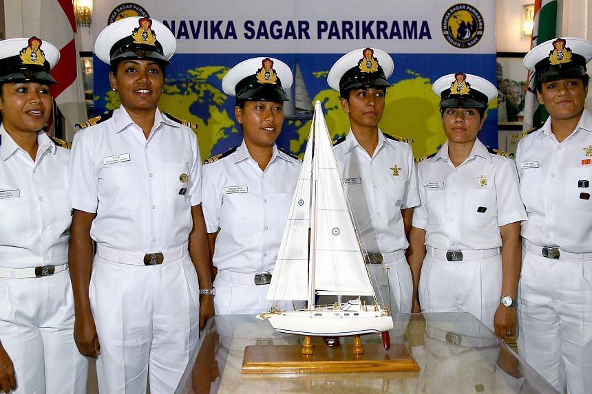 Indian women naval officers stand in front of a model of a yacht in New Delhi on Aug 17, 2017 , promoting their upcoming effort to sail around the world.