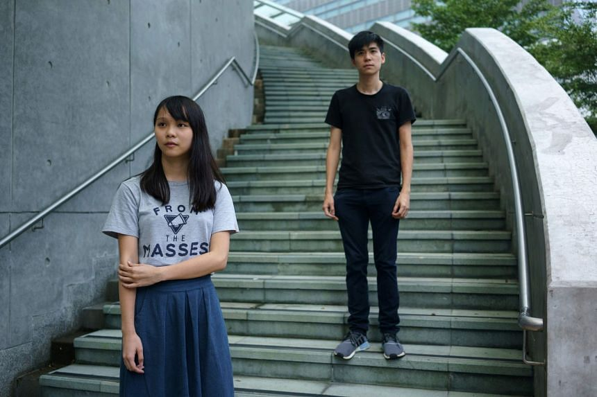 MS AGNES CHOW, (right, with fellow activist Lester Shum), on how the Hong Kong government is using the jail sentences for Joshua Wong, Nathan Law and Alex Chow to scare people away from social movements. Ms Chow is one of the best-known faces of the
