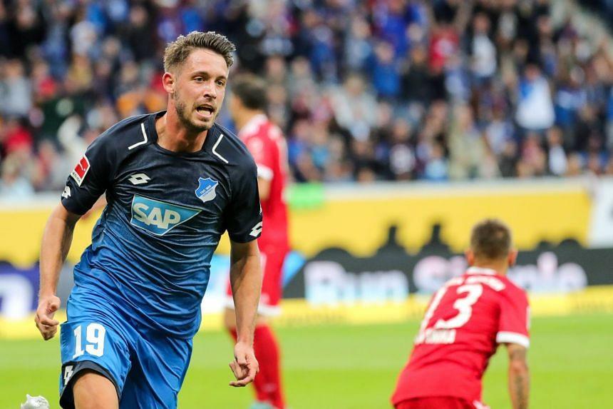 Hoffenheim's Mark Uth celebrates scoring the 1-0 goal.