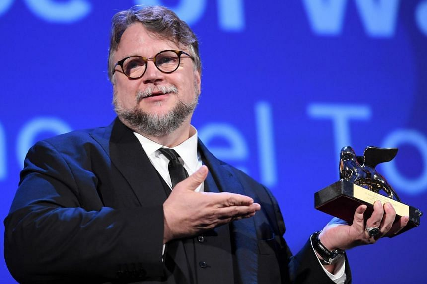 Guillermo Del Toro holds the Golden Lion award he received for his movie The Shape Of Water.