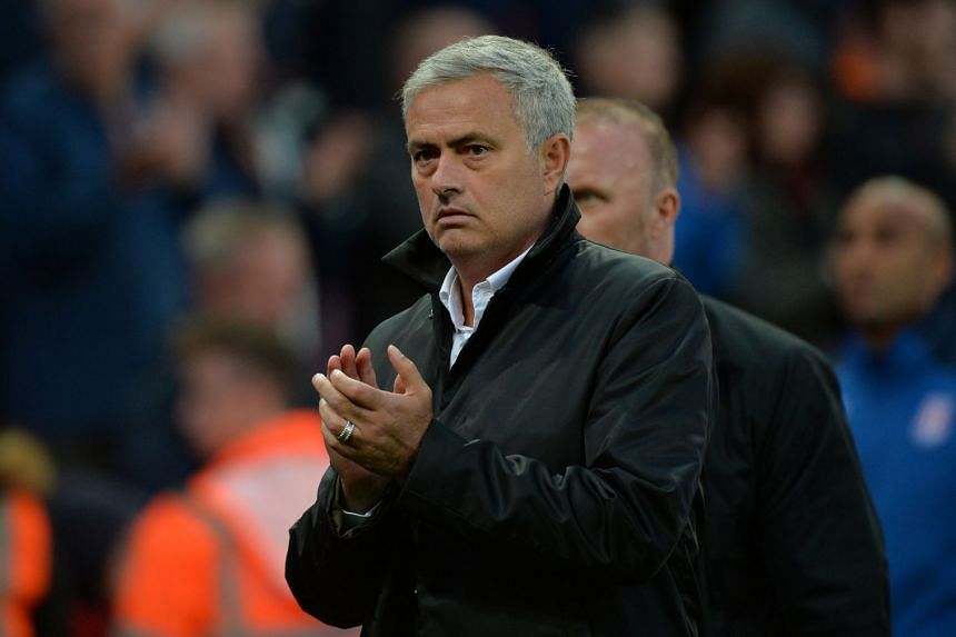 Manchester United manager Jose Mourinho applauds the fans at the end of the match.