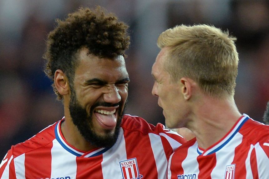 Stoke City's Eric Maxim Choupo-Moting celebrates with Darren Fletcher at the end of the match.
