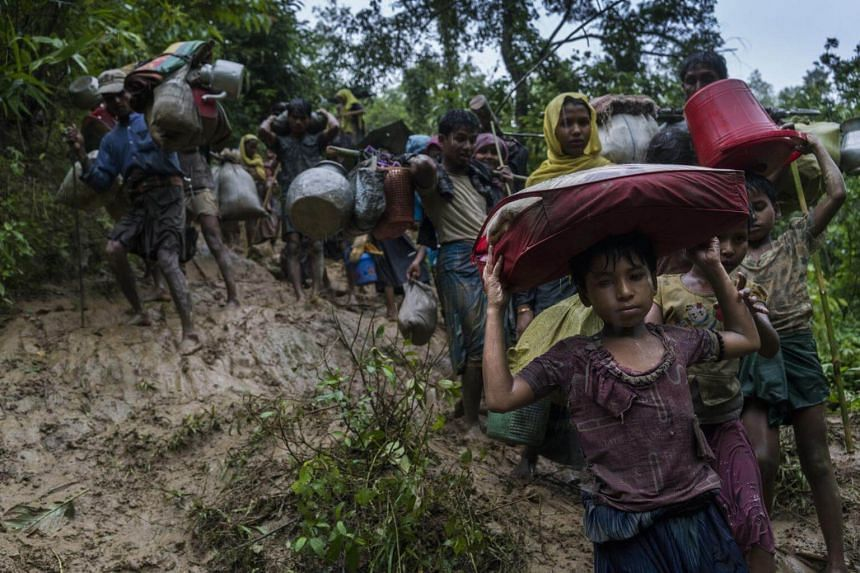 Rohingya refugees from Myanmar after crossing the border illegally near Amtoli, Bangladesh, on Aug 31, 2017.