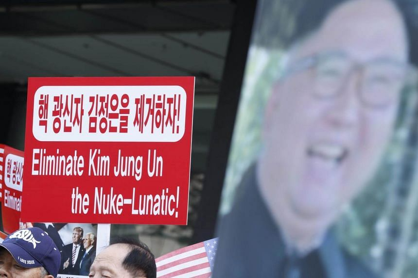 North Korean defectors and activists shout slogans next a portrait of North Korea's leader Kim Jong Un during a rally against North Korea's sixth nuclear test, in downtown in Seoul, on Sept 8, 2017.