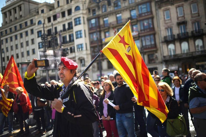 A protester carrying the Catalan separatist flag during a demonstration in Bilbao, Spain on Sept 9, 2017.