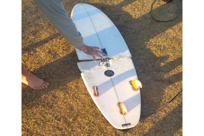 The man, named in local media as a Mr Abe McGrath, was surfing at Iluka in New South Wales early on Sunday when his board was hit from below by what he assumed was a shark, police said.