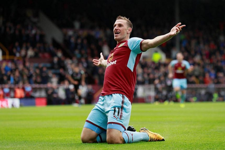 Burnley's Chris Wood celebrates scoring their first goal during the Premier League in Burnley, Britain, on Sept 10, 2017.