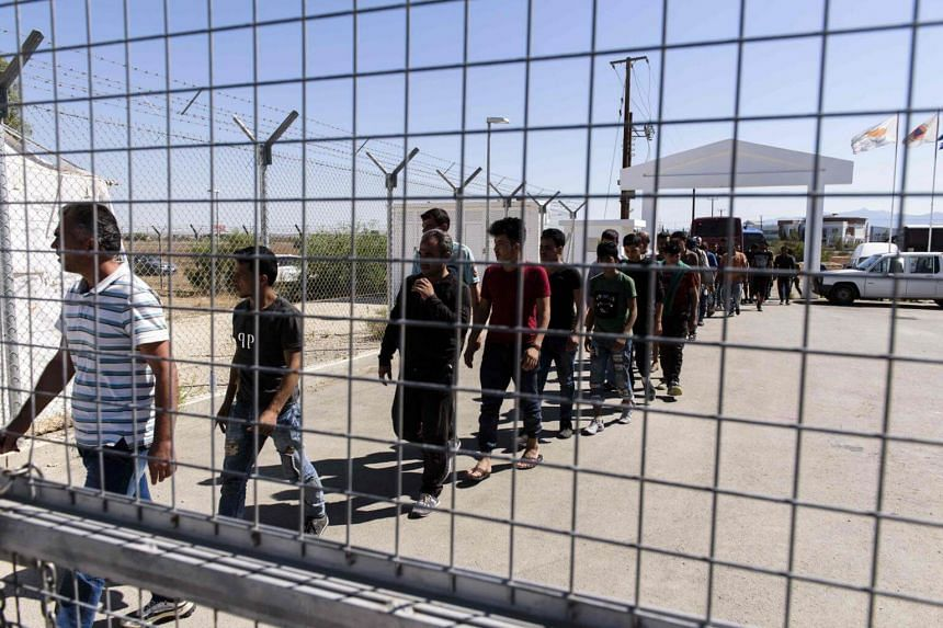 Syrian refugees queue as they arrive at the Kokkinotrimithia refugee camp, some 20 kilometres outside the Cypriot capital Nicosia, on Sept 10, 2017, after they were rescued off the northwestern coast of the island.