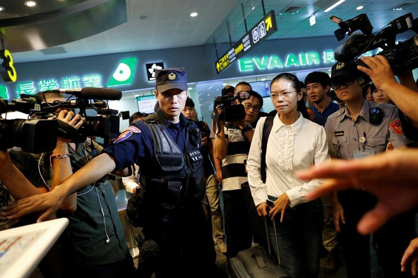 Lee Ching-yu, wife of Taiwan human rights advocate Lee Ming-che, also known as Li Ming-Che, who has been detained in China, departs for her husband's trial from the airport in Taipei, on Sept 10, 2017.