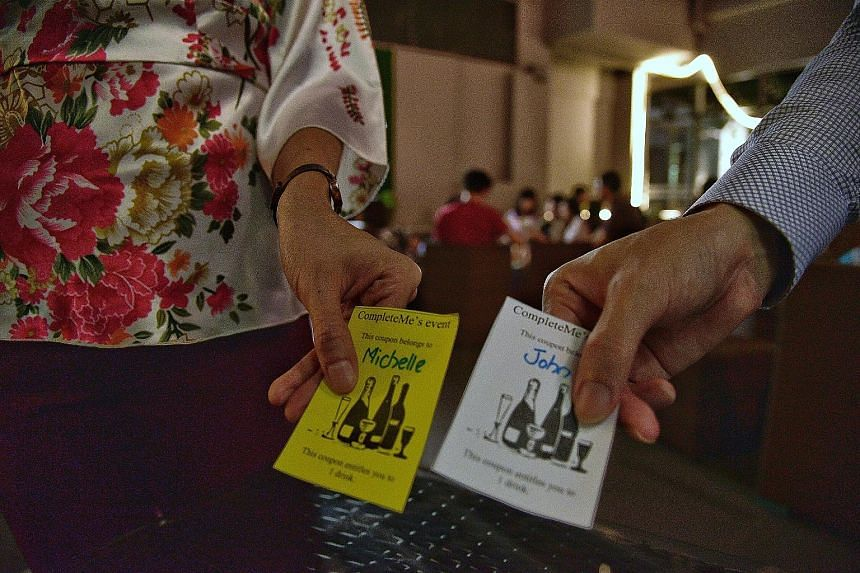 Drink coupons for participants at the event organised by dating agency CompleteMe last night. More than 40 people turned up, divorcees and the widowed among them. There were equal numbers of men and women, say the organisers.