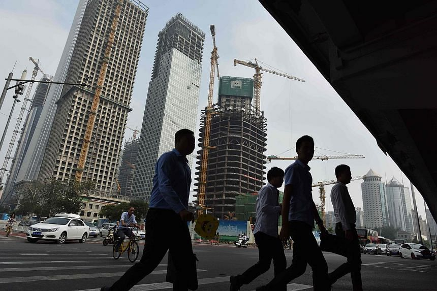 Building activity in Beijing's central business district. China's year-long, government-led construction boom, a resilient property market and a recovery in exports have combined to offset the expected drag from a regulatory crackdown on riskier type