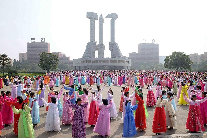Members of the North Korean women's union taking part in a dance in Pyongyang to mark the 69th anniversary of the country's founding yesterday.
