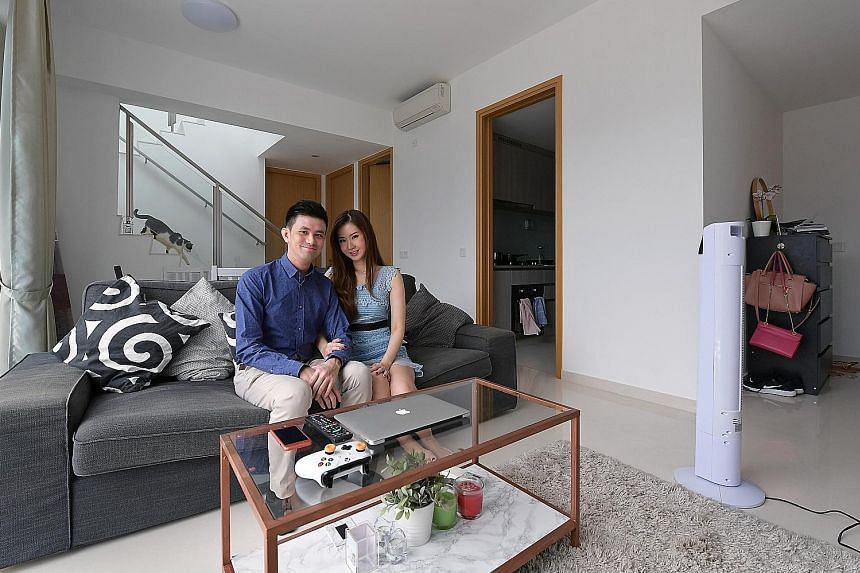 Mr Chiew's penthouse property in the Bartley area. His dream home, he says, would preferably be a landed property in a quiet, central part of Singapore, with room for about six people. Mr Eric Chiew, 33, and his wife Janet Tay, 32, in the three-bedro