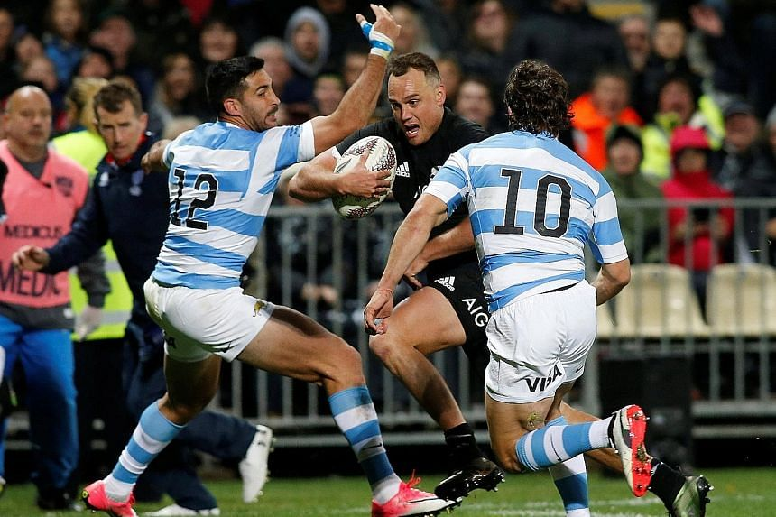 New Zealand's Israel Dagg charging his way through Argentina's defence to score a try. The Pumas gave the All Blacks, who will play the Springboks on Saturday in Auckland, a scare before the home side ran out convincing winners.