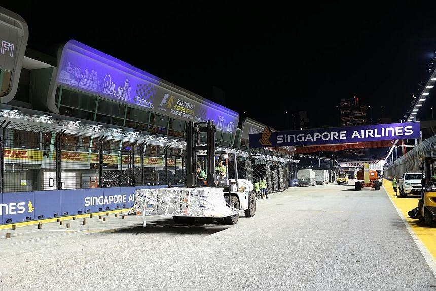 A forklift driver moving goods around the Formula One Pit Building, as it gears up to host the F1 Singapore Airlines Singapore Grand Prix next weekend. Over 700 tonnes of equipment are expected to be fitted into the garages as well as other parts of