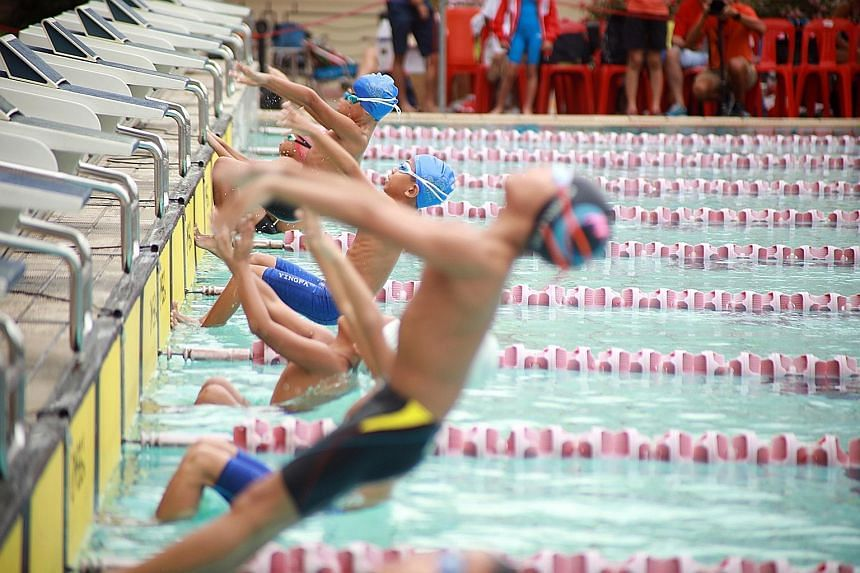 The start of the boys' Under-nine 25m backstroke event at the Singapore Swimming Club yesterday. The Open Invitational Midget Meet, now in its 23rd edition, is Singapore's only swimming competition for nine-year-olds and below. Fifteen local and fore
