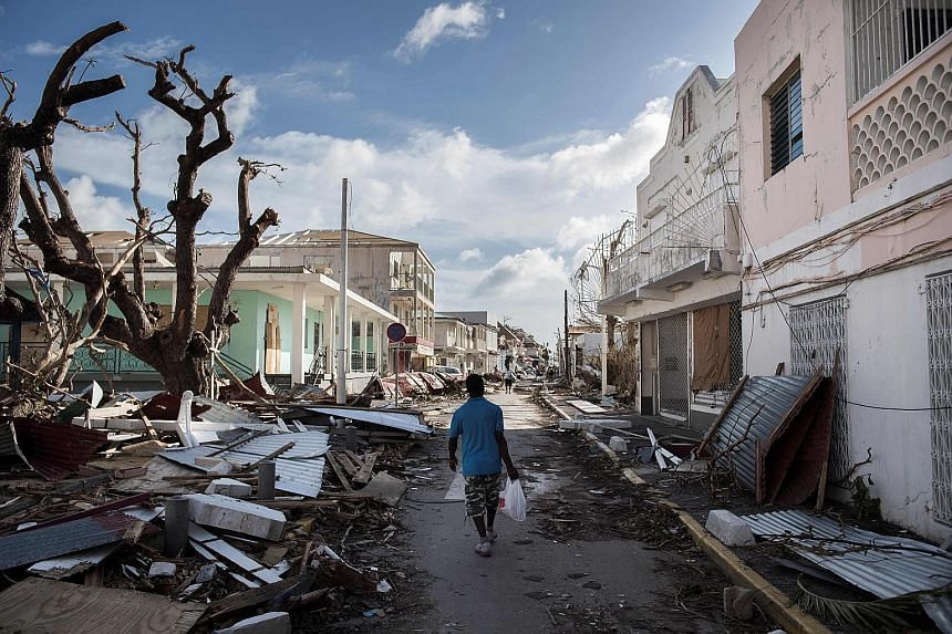Police patrolling a street in San Juan, Puerto Rico, last Wednesday as Hurricane Irma slammed across islands in the northern Caribbean. Pleasure craft lying crammed against the shore in Paraquita Bay as the eye of Hurricane Irma passed Tortola, on th