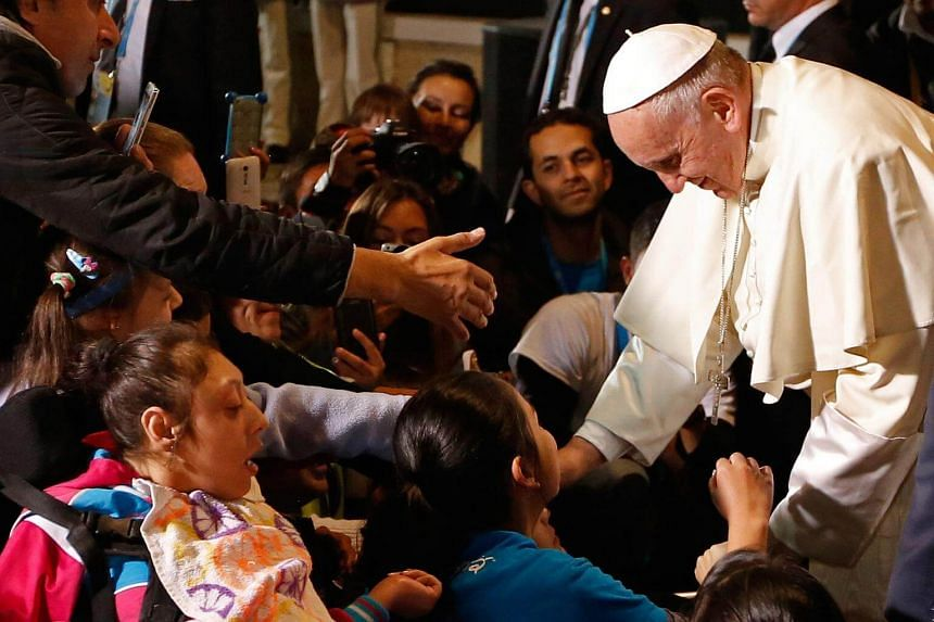 Pope Francis greets children during a ceremony at the Nunciature in Bogota, Colombia, on Sept 9, 2017.