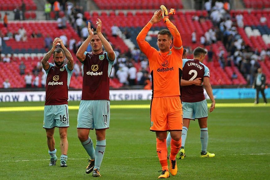 (From left) Burnley's Steven Defour, Chris Wood and Tom Heaton applaud the supporters after the English Premier League football match between Tottenham Hotspur and Burnley at Wembley Stadium in London, on Aug 27, 2017.