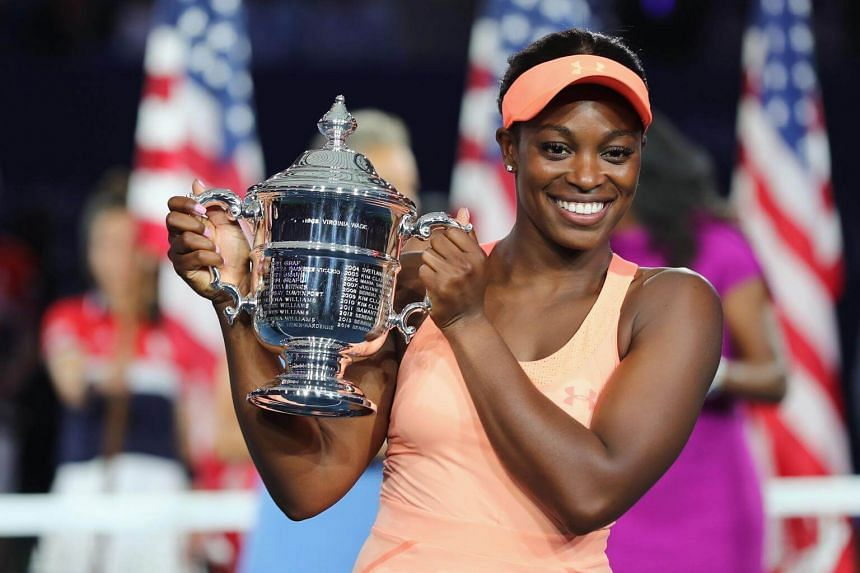 Sloane Stephens poses with the US Open trophy after beating compatriot Madison Keys to win her first Grand Slam.