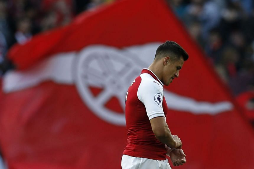 Arsenal's Chilean striker Alexis Sanchez walks off the pitch at full-time, Sept 9, 2017.