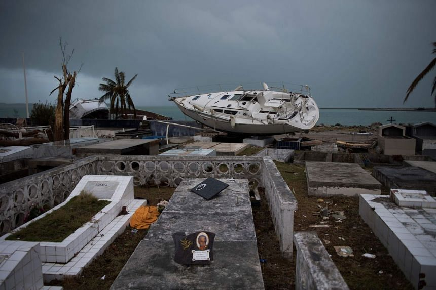 A sailing boat is beached in the cemetery of Marigot, on Sept 9, 2017, in Saint-Martin, after Hurricane Irma.