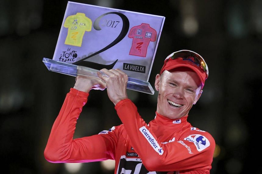 British cyclist Chris Froome, winner of the La Vuelta cycling race, poses on the podium in Madrid, Spain, on Sept 10, 2017.