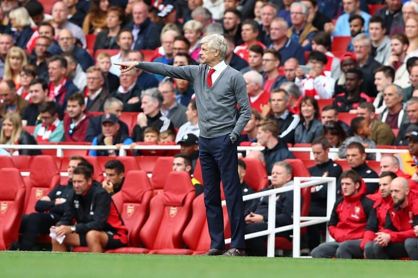 Arsenal's head coach Arsene Wenger reacts during the English Premier League soccer match between Arsenal FC and AFC Bournemouth at the Emirates stadium, in London, on Sept 9, 2017.