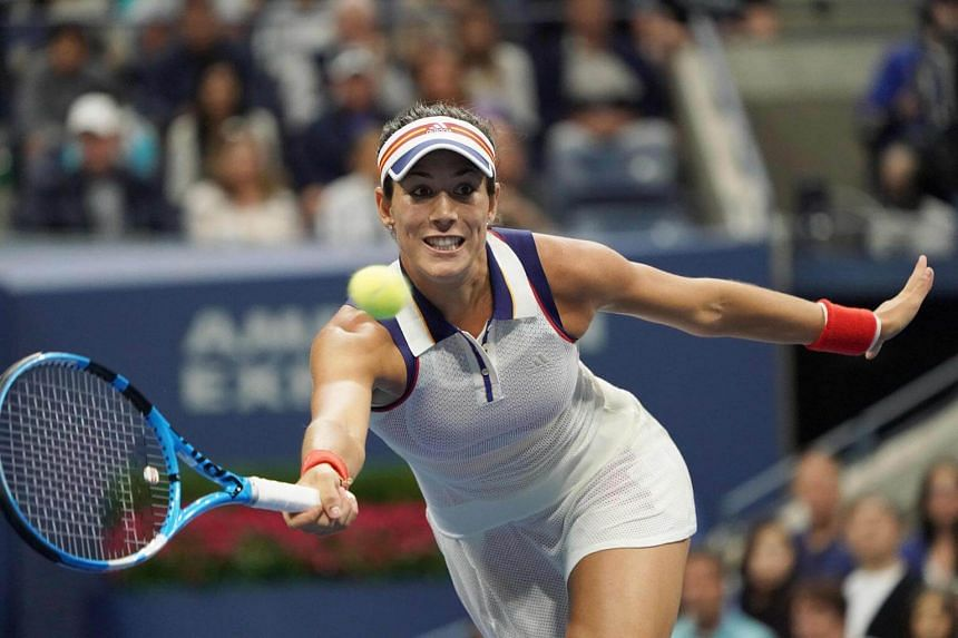 Garbine Mugurusa of Spain hits a return to Petra Kvitova of the Czech Republic during their 2017 US Open Women's Singles match at the Usta Billie Jean King National Tennis Center in New York, on Sept 3, 2017.