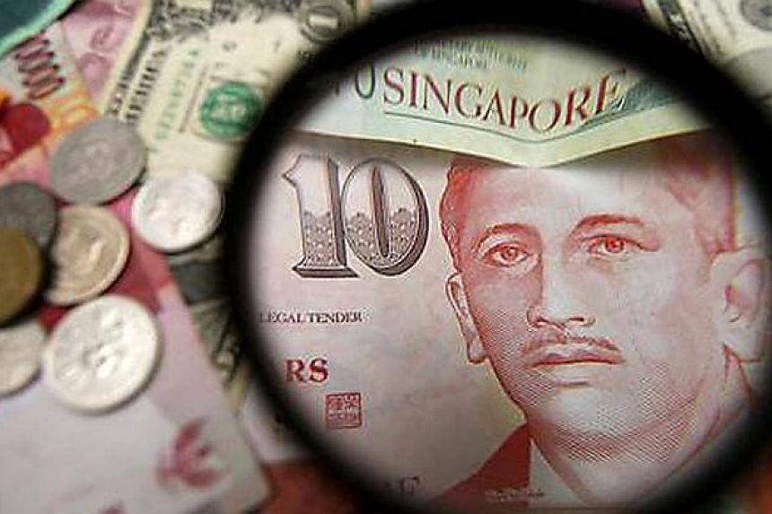The Singdollar weakened 0.5 per cent to 1.3436 per US dollar as of 2:45pm on Monday.