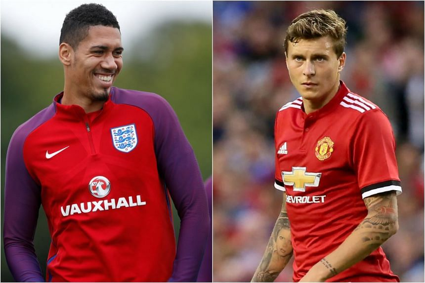 Chris Smalling (left) and Victor Lindelof will start at the heart of Manchester United's defence when they host FC Basel on their Champions League return on Tuesday (Sept 12).