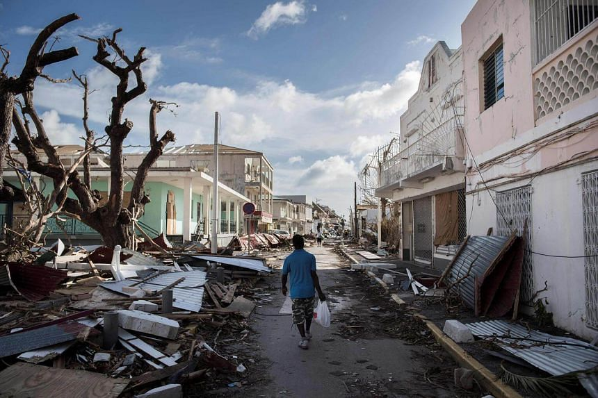 A man walks on a street in St Martin, on Sept 8, 2017, after the island was damaged by Hurricane Irma.