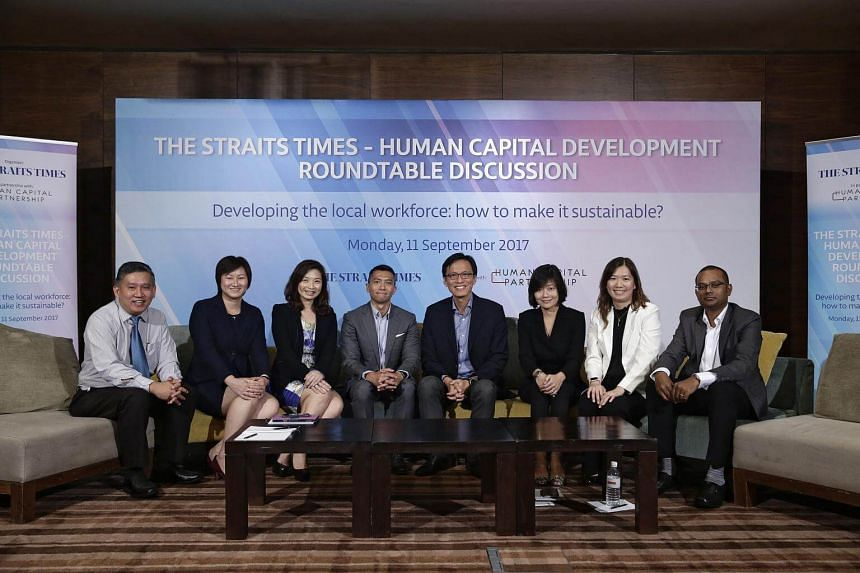 (from left) Toh Yong Chuan, Ms Selena Huynh, Ms Merle Chen, Mr Kenneth Wong, Mr Russell Tham, Ms Cham Hui Fong, Ms Julia Yeo and Mr Krishnakumar Rajan, at Grand Hyatt Singapore on Sept 11, 2017.