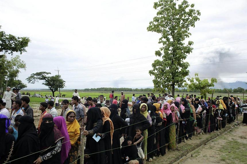 Rohingya refugees in a queue as they wait to receive aid relief in Teknaf, Bangladesh, on Sept 10, 2017.