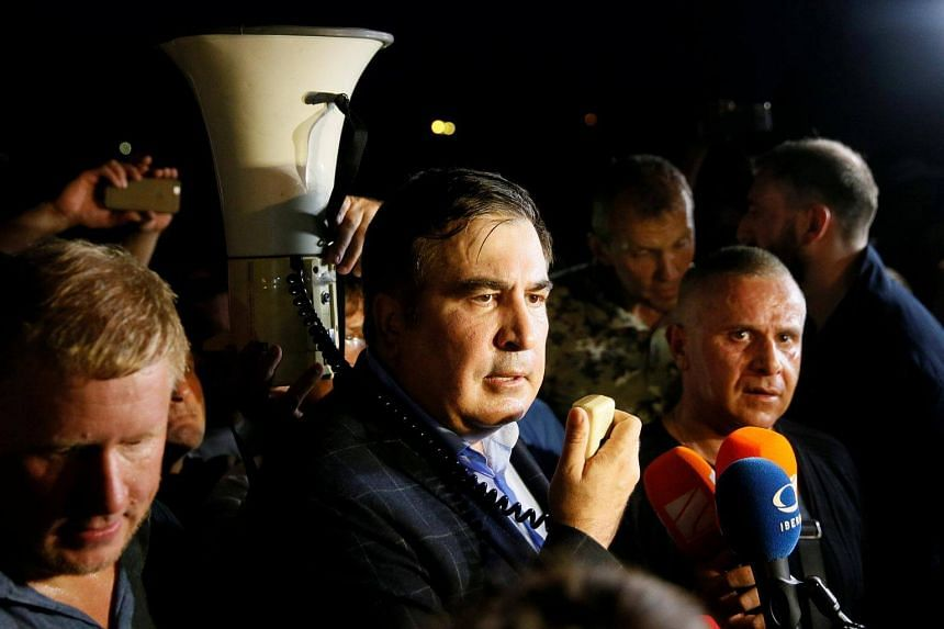Former Georgian President Mikheil Saakashvili speaks after he and his supporters barged past guards to enter Ukraine from the Polish border, at a checkpoint in Shehyni, Ukraine, on  Sept 10, 2017.