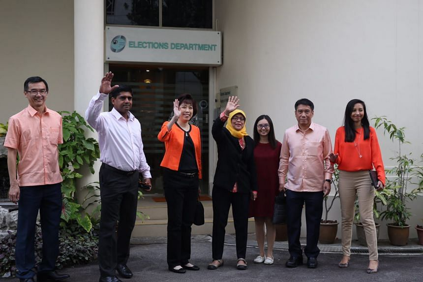 Madam Halimah Yacob and her supporters arrive at the Elections Department.