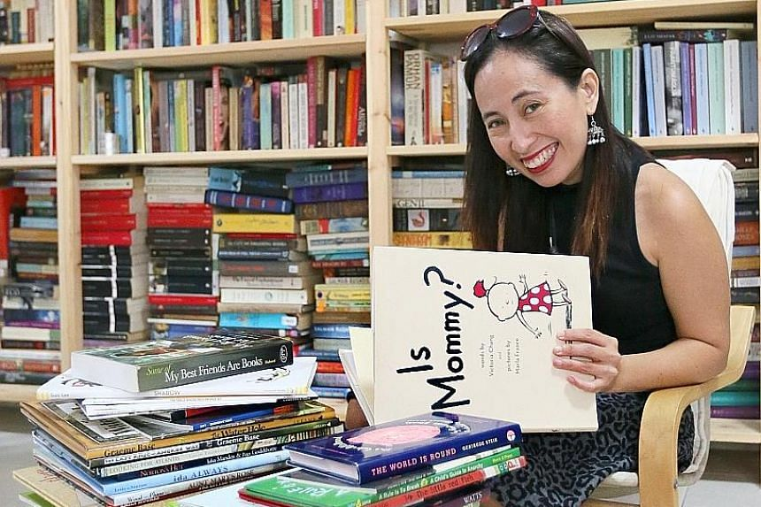 Assistant Professor Myra Garces-Bacsal with her collection of picture books at the National Institute of Education.