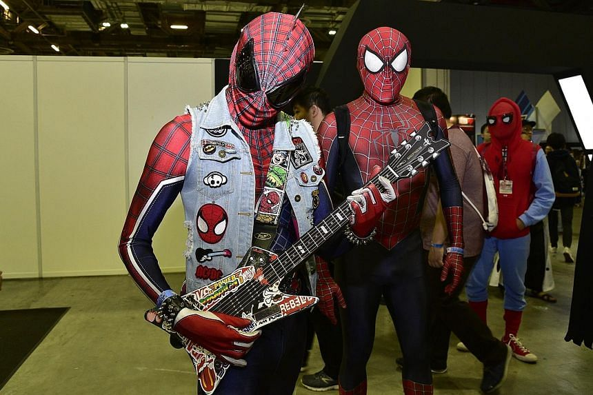 Cosplayers came dressed as, among other characters, Spider-Men (above) and Harley Quinn; while other attendees crossed lightsabers for a wefie.