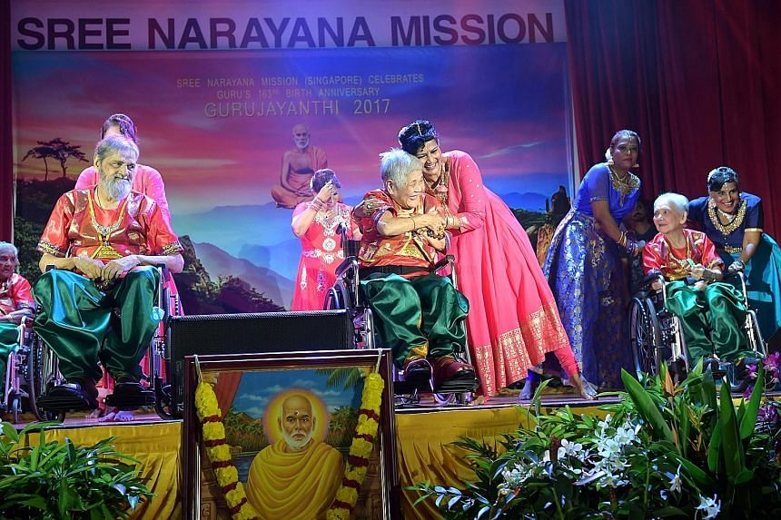 Sree Narayana Mission Nursing Home resident Tan Geok Kuan (centre) performing during the mission's celebrations yesterday to mark 163 years since Indian philosopher Sree Narayana Guru's birth.