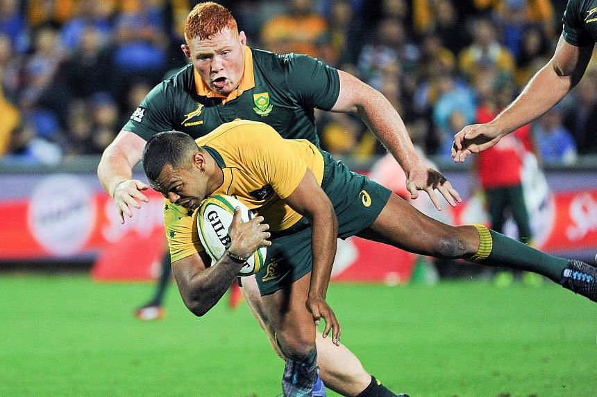 Australia's Kurtley Beale charging through the Springboks' backline. The Wallabies will again turn to their standout player ahead of Saturday's Test against Argentina.
