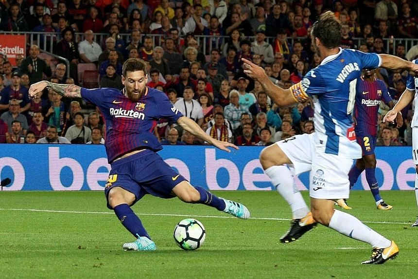 Lionel Messi scoring his first goal in the emphatic 5-0 victory over local rivals Espanyol in their LaLiga encounter on Saturday.