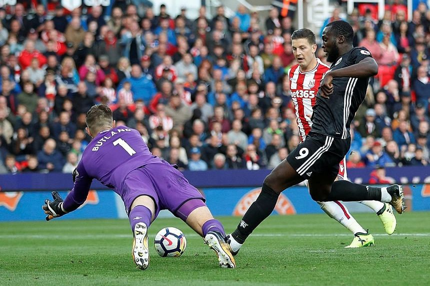 Manchester United's Romelu Lukaku scoring their second goal in the 2-2 Premier League draw against Stoke City on Saturday. In the 81st minute, however, the Belgian squandered a chance to seal a win against the Potters.