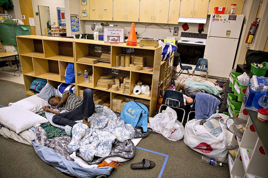 The docks of the Florida Keys (left) being battered by rough surf churned up by the approaching Irma on Saturday while Florida residents took refuge in shelters like this one at a school in Tampa. A scene after the passage of Hurricane Irma in the Cu