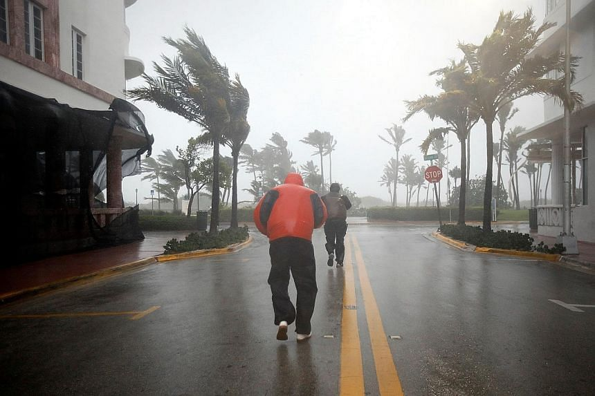 People running to safety in South Beach yesterday as Hurricane Irma started its onslaught in south Florida. At least one million homes and businesses were left without power, in what could end up being the most expensive storm in United States histor