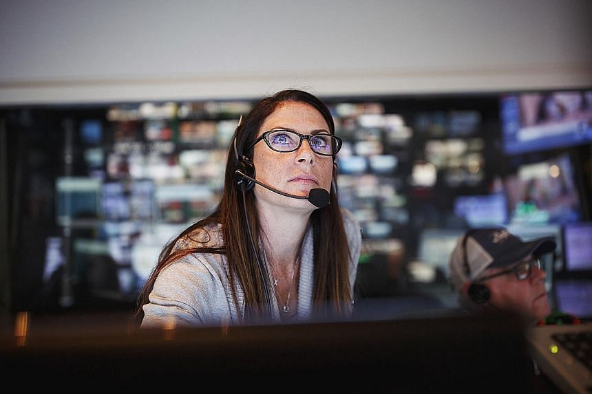 Ms Nora Zimmett, senior vice-president of programming for the Weather Channel, at work in Atlanta on Friday as Hurricane Irma approached Florida.