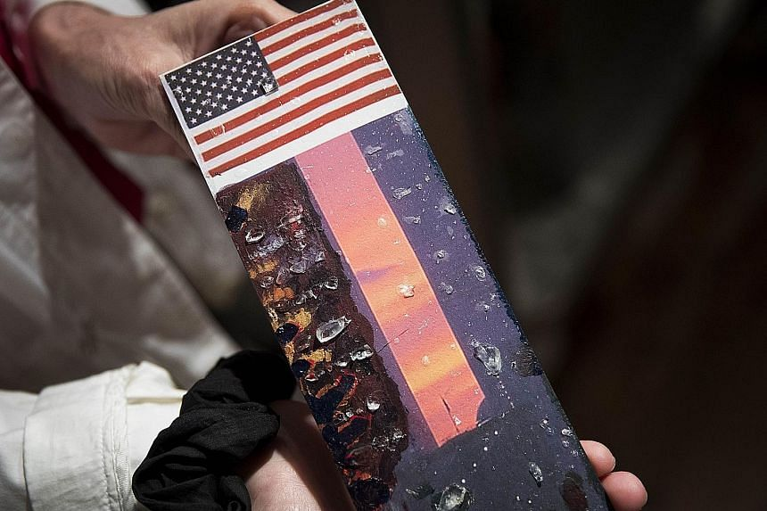 """Artist Marie-Hlne holding last Thursday her piece of artwork, titled Metamorphosis, made from original steel and window glass from the World Trade Center. The anniversary of the attacks on the twin towers is the """"most dreaded date"""" of the year and po"""