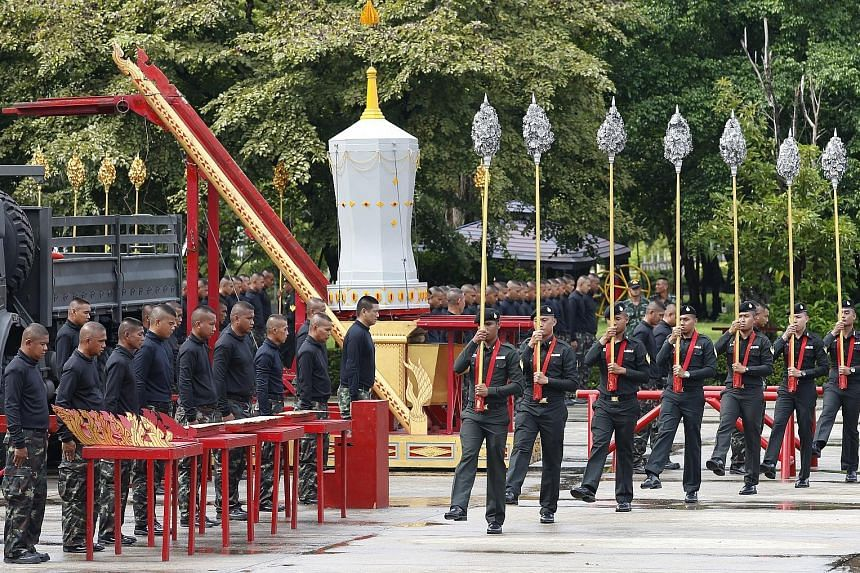 Royal Thai Army officers in training last Thursday for the ceremony, set to start on Oct 25. Those chosen to pull the funeral chariots had to pass strength and endurance tests.